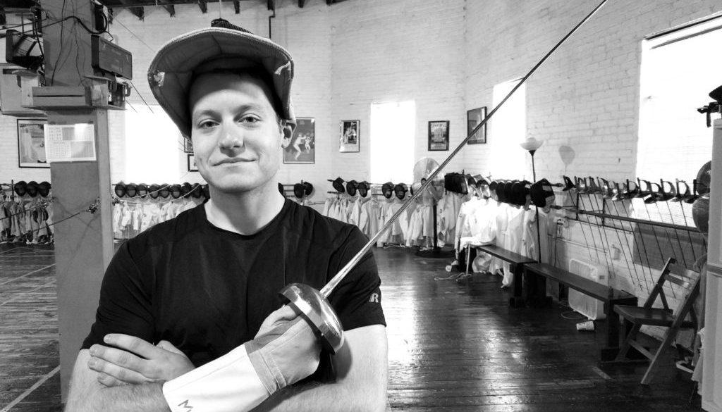 Trevor Herrin, epee, black and white, promotional photo