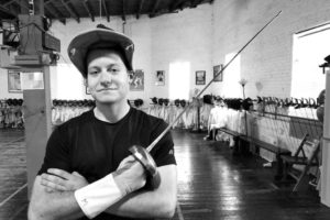 Trevor Herrin, epee, black and white, promotional photo