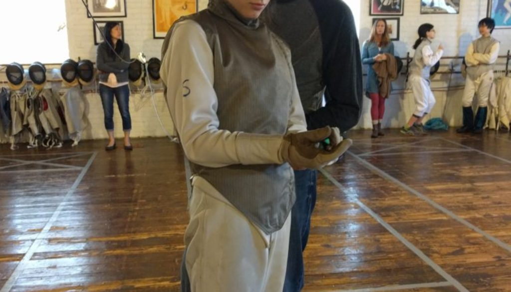 Greta Tart, women's foil, with parent dad, tournament