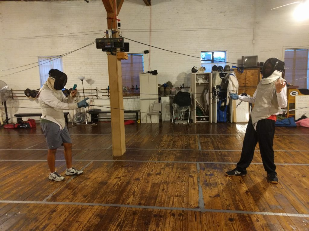 fencer on cell phone