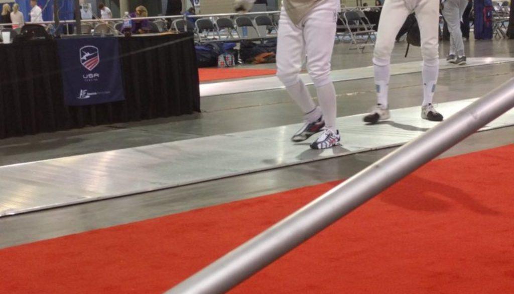 Coach Gerhard on strip fist pump at Richmond NAC, foil bout.